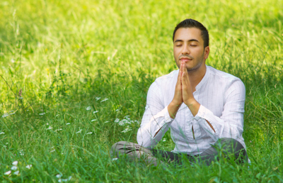Medieval young man praying in a forest-SMALL DOF